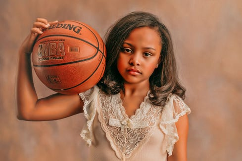 Photographer Heather Mitchell wanted to capture that girls can be both girly and athletic.