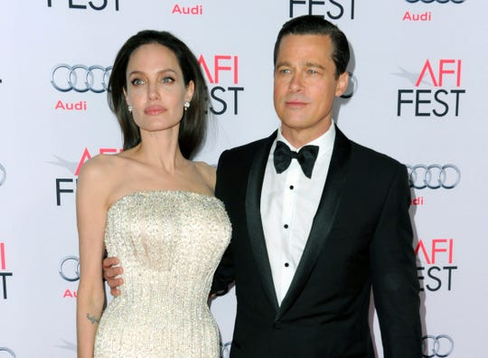 Angelina Jolie, left, and Brad Pitt (in 2015) are now officially single.