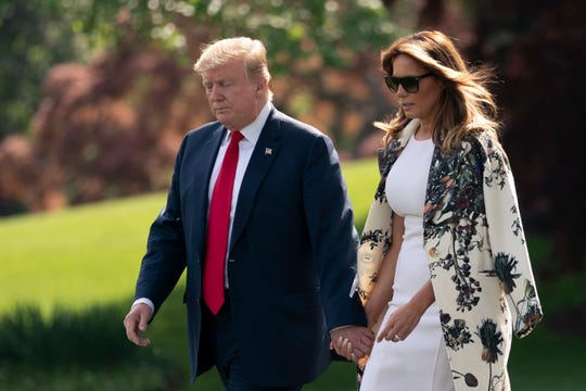 President Donald Trump and first lady Melania Trump walk to Marine One at the White House in Washington on April 18, 2019.