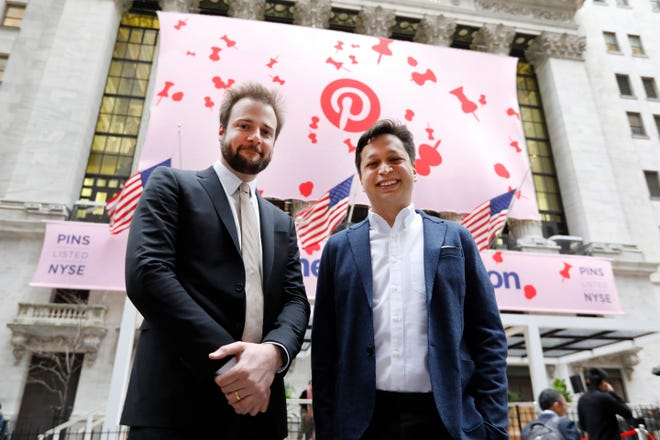 Pinterest co-founder & CEO Ben Silbermann, right, and fellow co-founder and chief product officer Evan Sharp, pose for photos outside the New York Stock Exchange, Thursday, April 18, 2019, before the company's IPO.