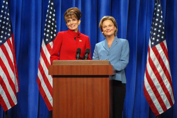 """Tina Fey as Sarah Palin and Amy Poehler as Hillary Clinton in the infamous 2008 """"I can see Russia from my house"""" sketch."""