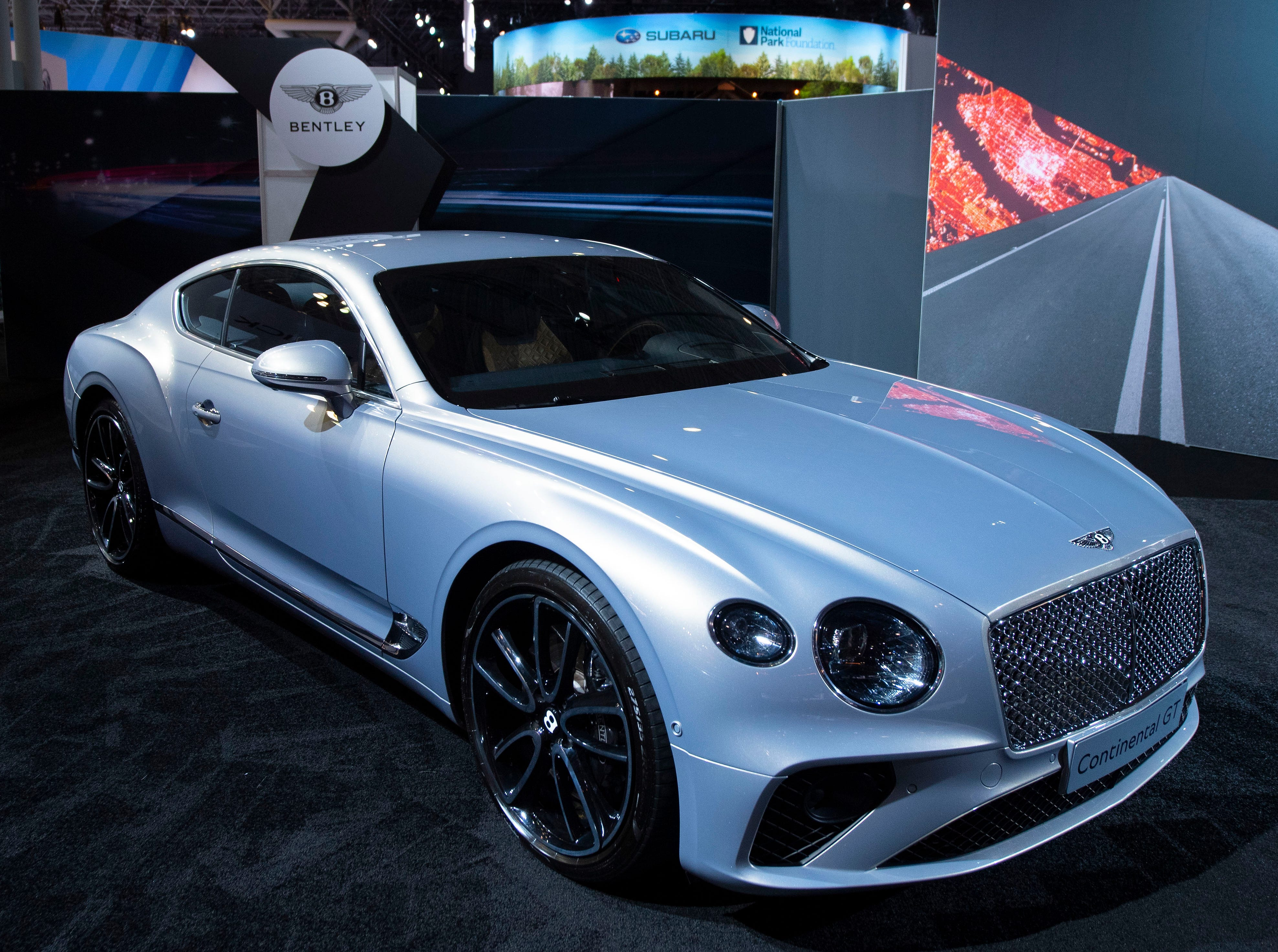 A Bentley Continental GT is one of the exotic cars are on display at the New York International Auto Show.