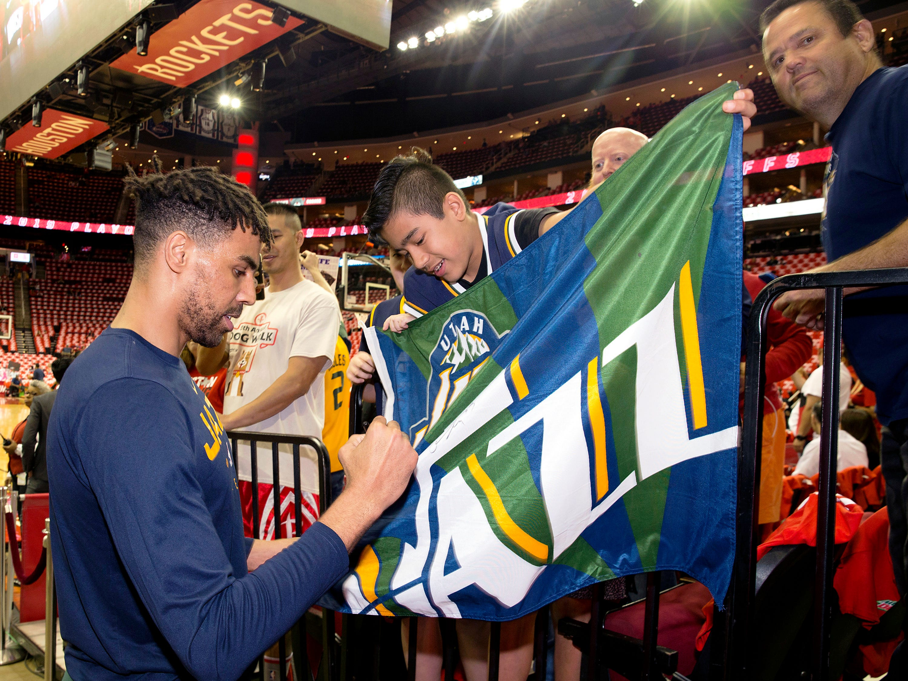 April 17: Jazz forward Thabo Sefolosha signs a fan's banner before Game 2 against the Rockets in Houston.
