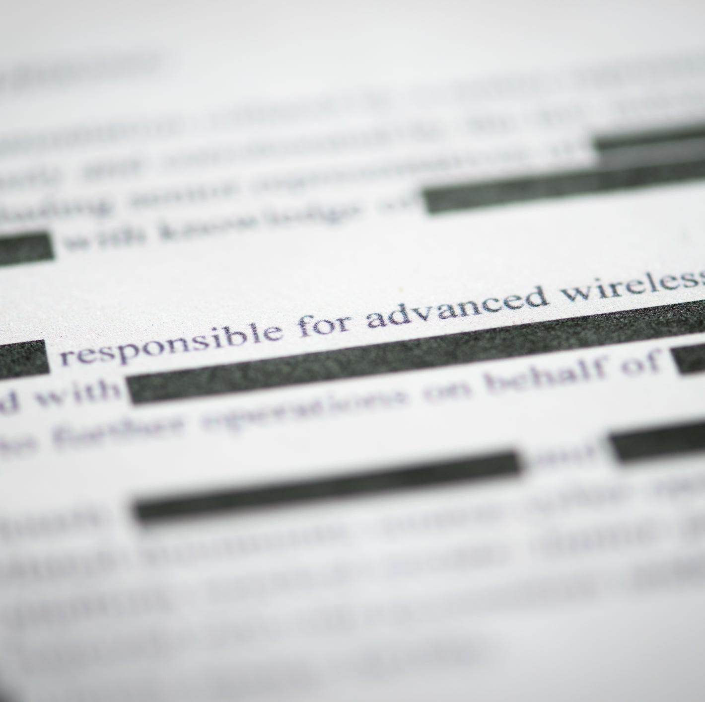 A redacted document with censored words blacked-out.