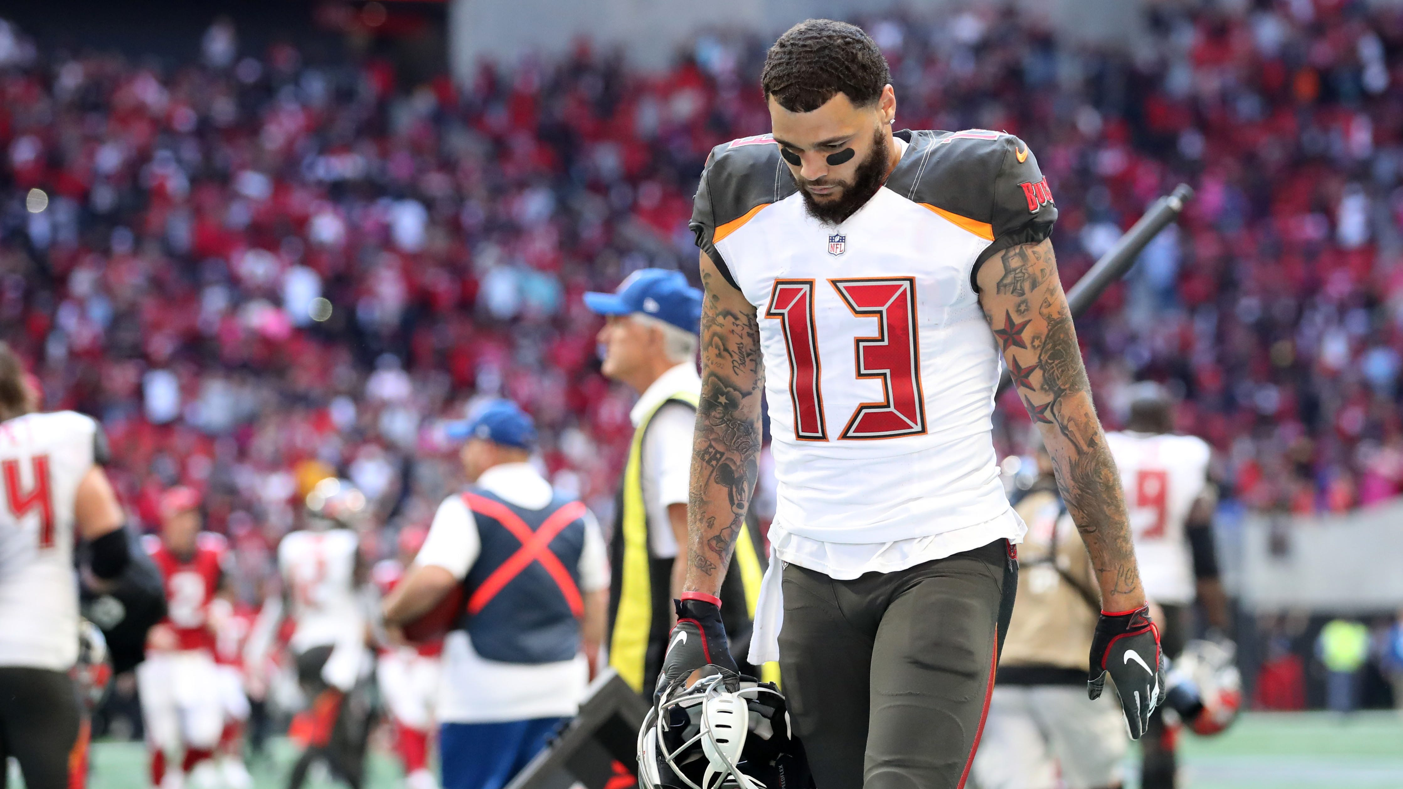 Tampa Bay Buccaneers wide receiver Mike Evans (13) reacts after their loss to the Atlanta Falcons at Mercedes-Benz Stadium.