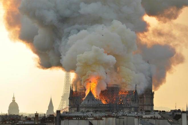 Flames and smoke rise from the blaze at Notre Dame Cathedral on April 15, 2019.