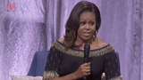 Former First Lady Michelle Obama took a little bit of an indirect swipe at President Trump at an event with Stephen Colbert.
