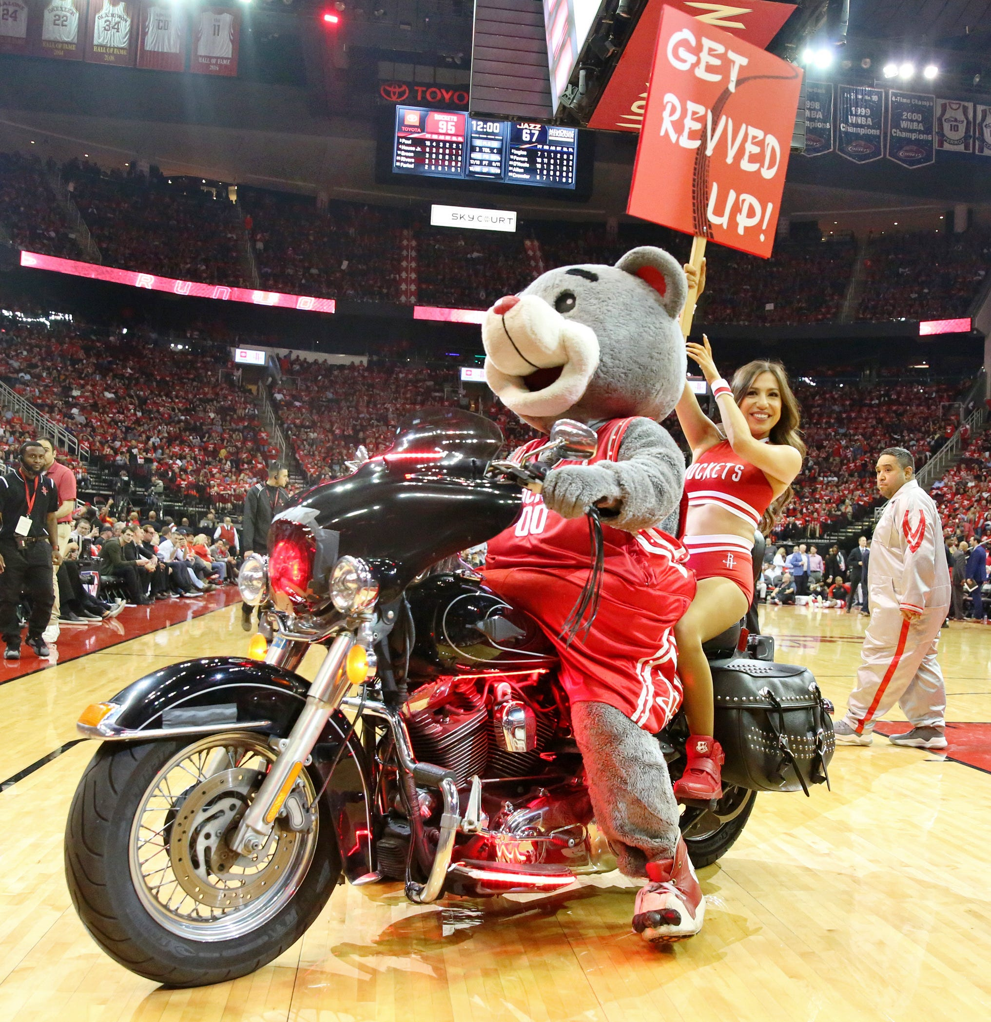 "April 17: Houston Rockets mascot ""Clutch"" and a Houston Rockets Power Dancer ride a Harley during Game 2 at Toyota Center. Thomas Shea, USA TODAY Sports"