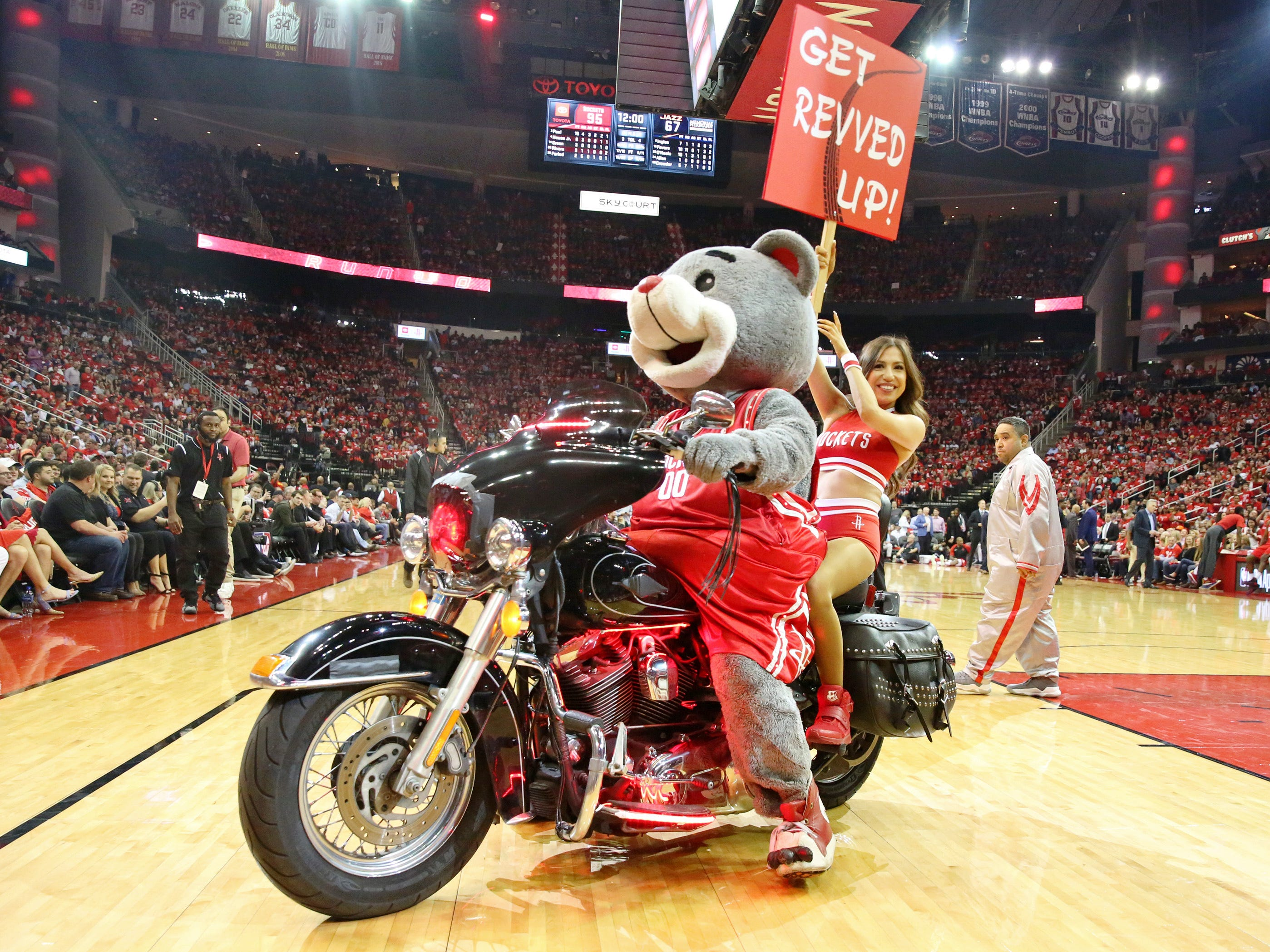 "April 17: Rockets mascot ""Clutch"" and a Rockets dancer ride a Harley during Game 2 at Toyota Center."