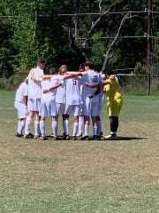 Westside soccer huddles before a match at the Nike Palmetto Cup