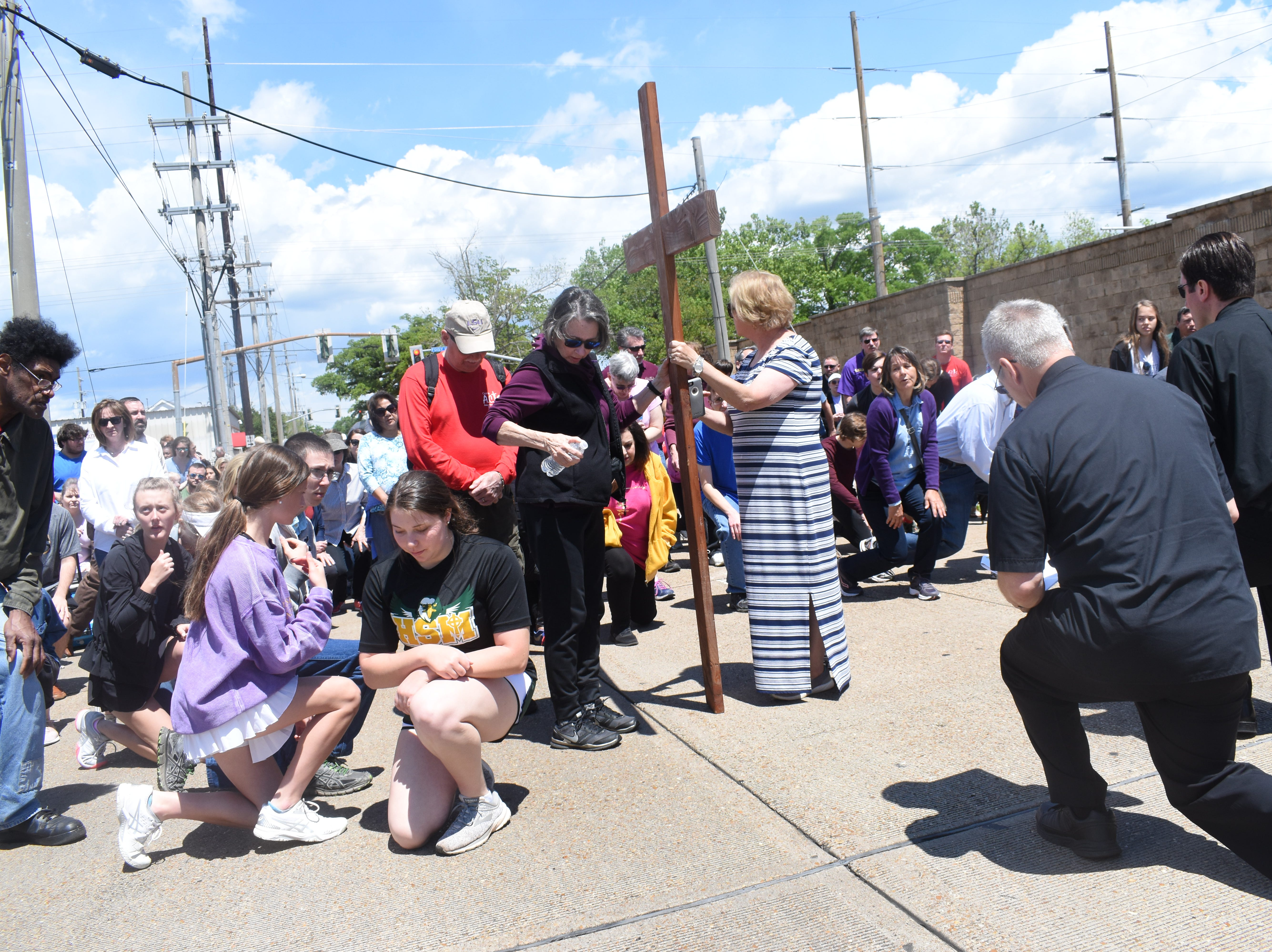 """Parishioners from the Catholic Diocese of Alexandria walk in the annual Passion Walk from St. Francis Xavier Cathedral on Fourth Street in downtown Alexandria to Our Lady of Prompt Succor Church on Elliott Street on Friday, April 19, 2019. The Friday before Easter is observed as Good Friday which is the day Christians observe as the Crucifixion of Jesus Christ. As parishioners walked, they stopped to pray at each of the 14 Stations of the Cross. Each station depicted the 14 events from Jesus Christ's last day on Earth. Father Dan O'Connor, pastor of Our Lady of Prompt Succor, said pausing at each station is a way to meditate on the """"things that happened to Jesus on the way to Calvary."""" Calvary is a hill near Jerusalem is where the Crucifixion took place.""""It's good for us to take some time today to remember Jesus' sacrifice for us so we could be forgiven of our sins,"""" said O'Connor."""