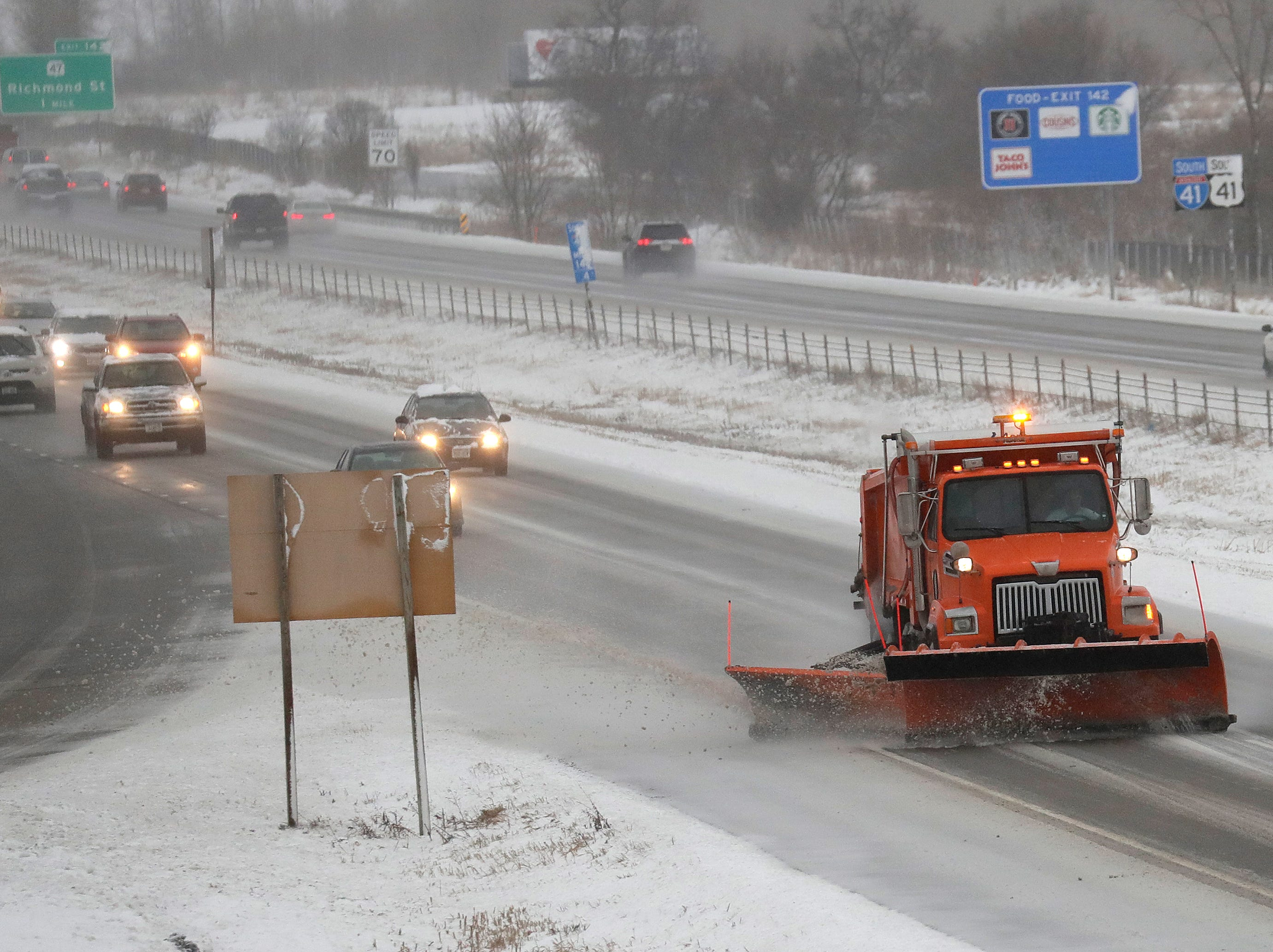 A plow clears snow for traffic traveling northbound on I-41 during a spring snow storm Thursday, April 11, 2019, in Appleton, Wis. Dan Powers/USA TODAY NETWORK-Wisconsin