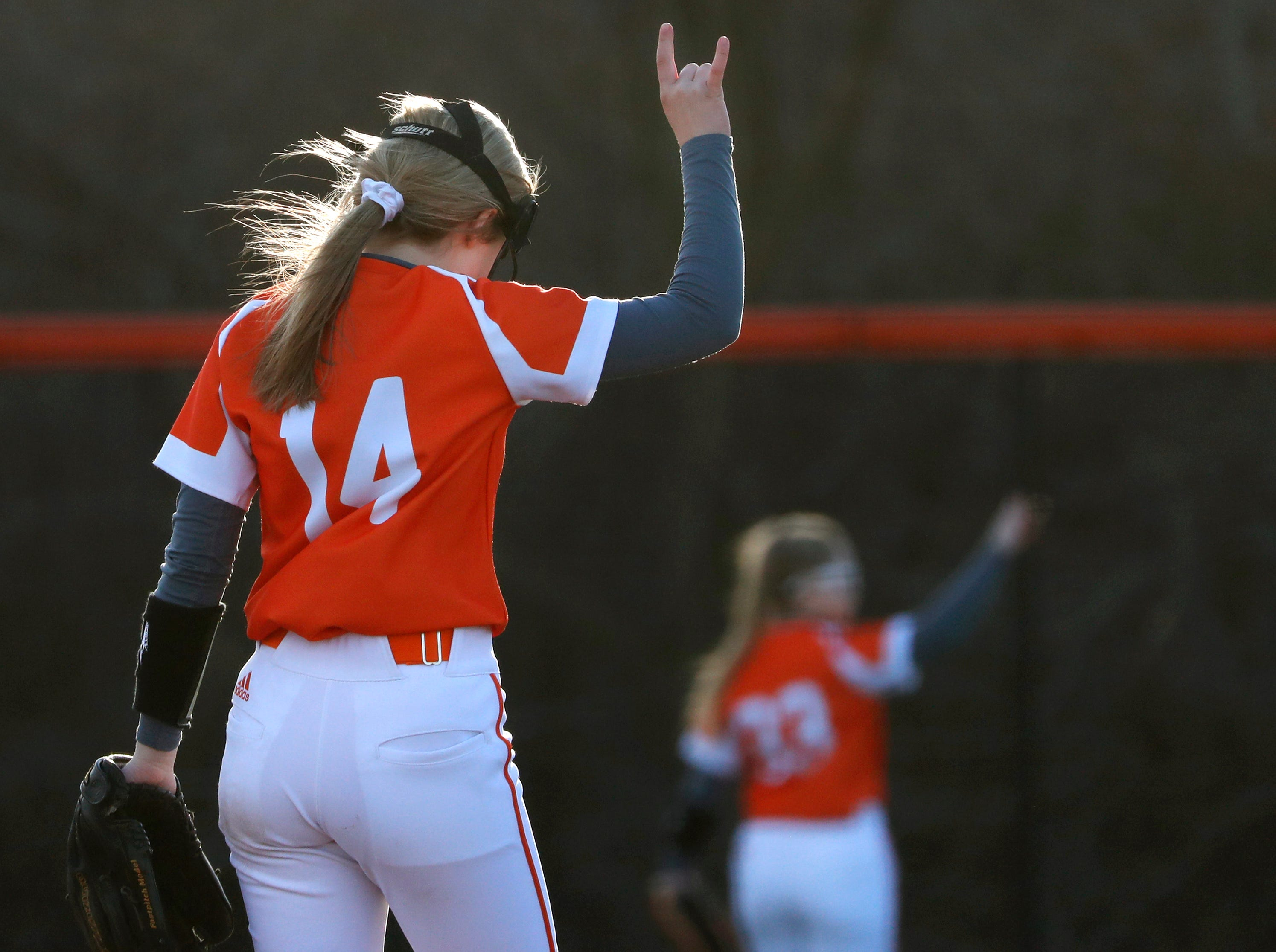 Kaukauna High School's Khloe Hinkens signals that there are two outs in the final inning of their game against Oshkosh West High School Tuesday, April 9, 2019, in Kaukauna, Wis. Kaukauna High School defeated Oshkosh West High School 3-1.Danny Damiani/USA TODAY NETWORK-Wisconsin