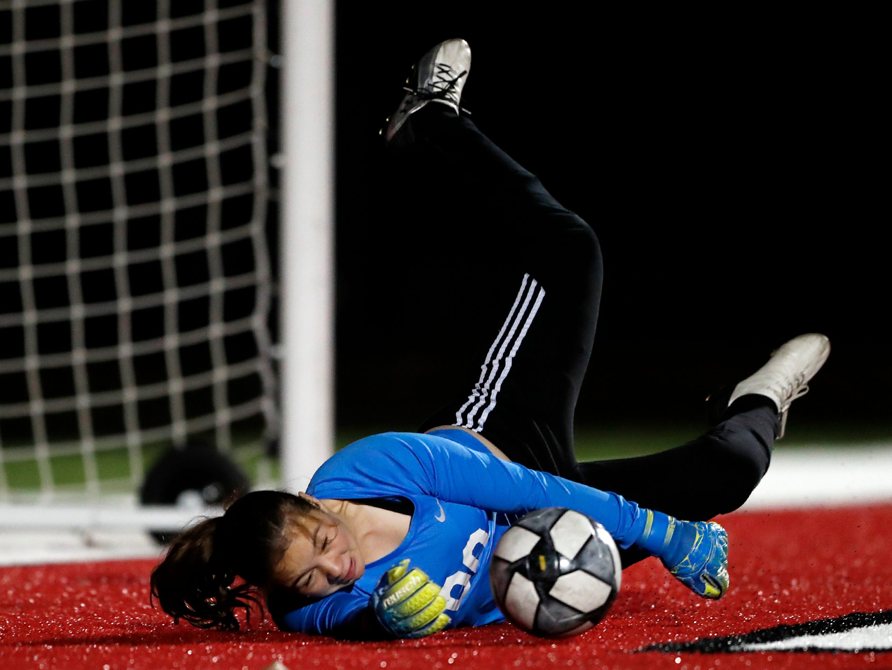 Green Bay East High School's Jordan Koch falls to the ground as she tries to make a save against Hortonville High School Monday, April 8, 2019, in Hortonville, Wis. Danny Damiani/USA TODAY NETWORK-Wisconsin