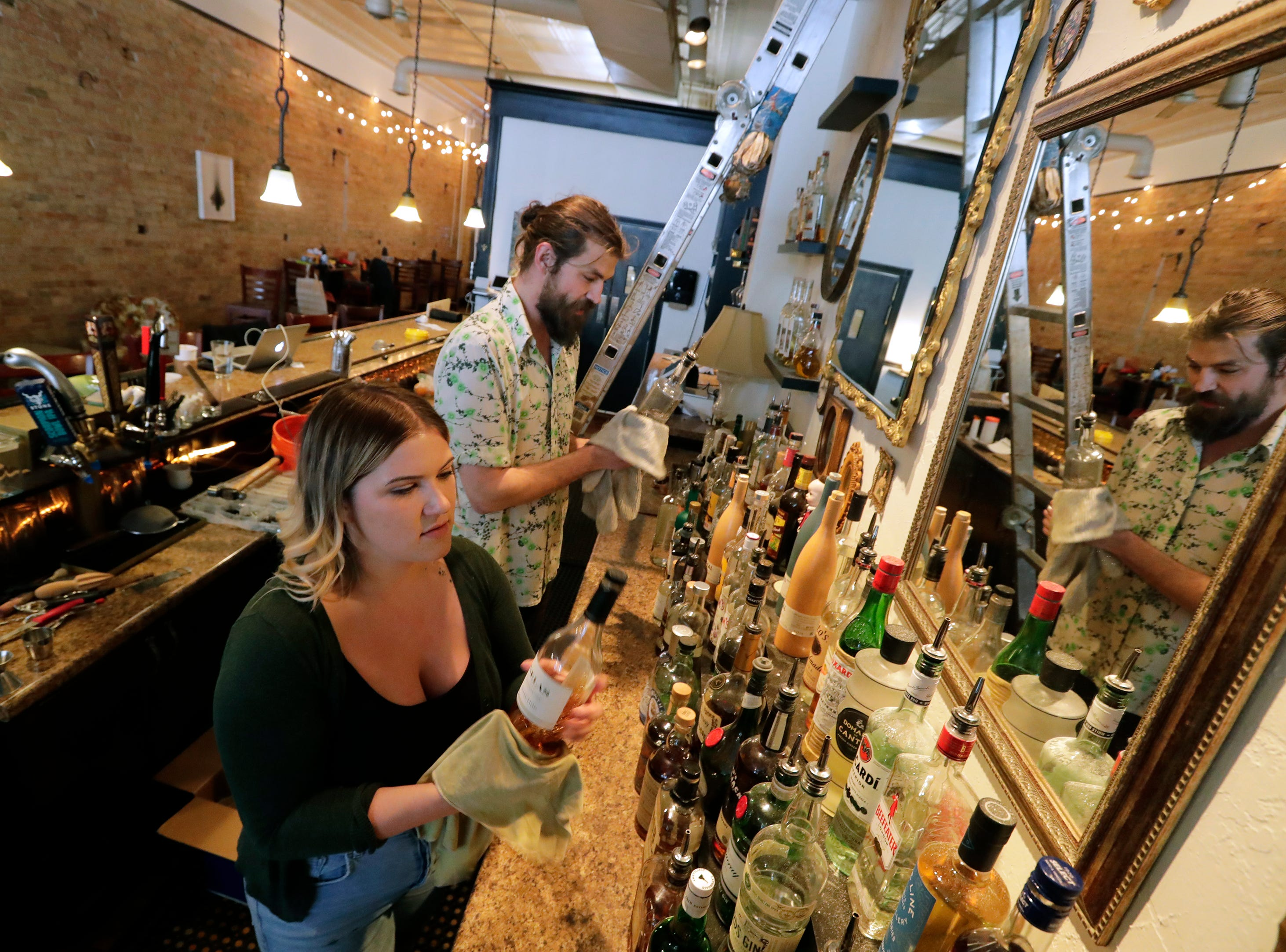 Proprietors Margot Reed, left, and Christopher Fenn clean and arrange the bar at Nice Time located at 125 E. College Avenue Friday, April 12, 2019, in downtown Appleton, Wis. Dan Powers/USA TODAY NETWORK-Wisconsin