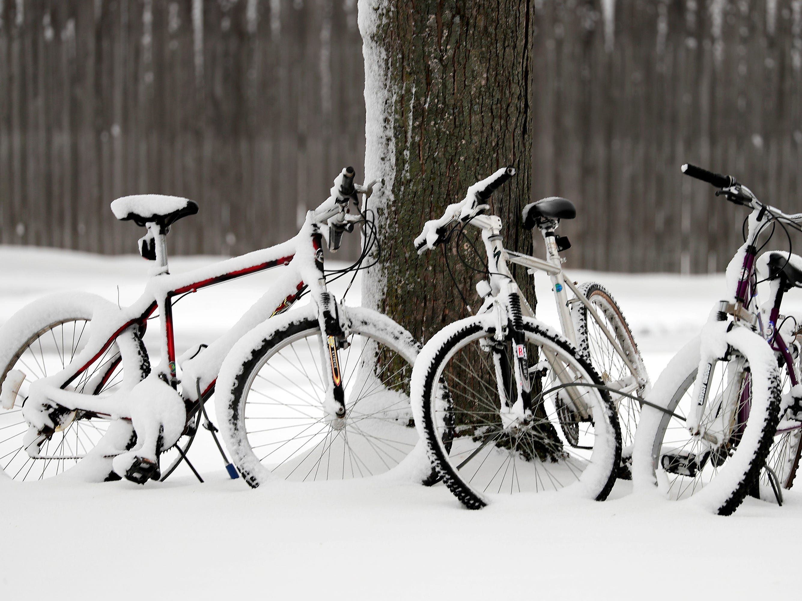 Bicycles blanketed in snow following a spring snow storm on Thursday, April 11, 2019, in Combined Locks, Wis. Wm. Glasheen/USA TODAY NETWORK-Wisconsin.