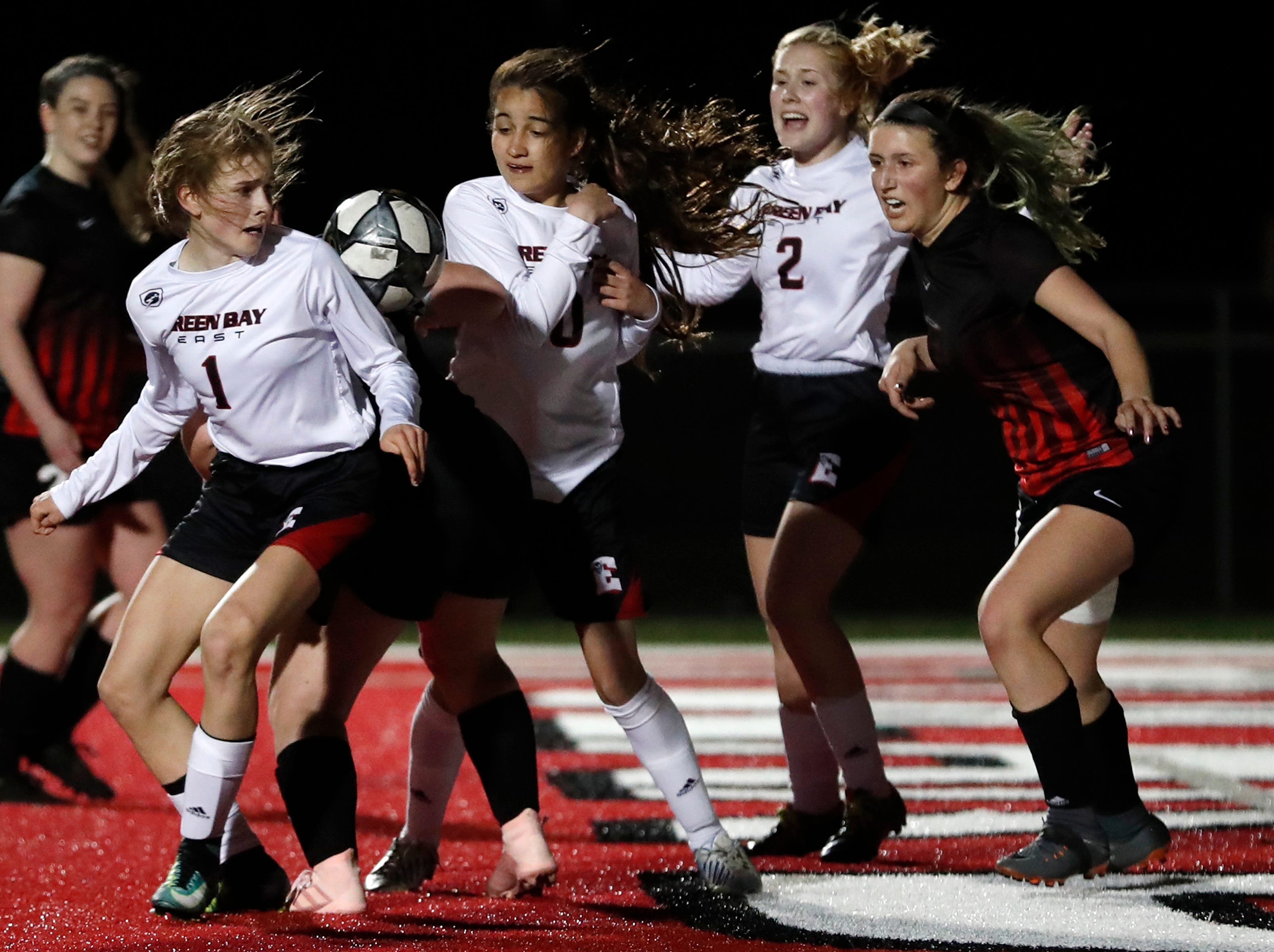 Green Bay East High School's Ellena Gallegas tries to turn toward the ball and face Hortonville High School's goal  Monday, April 8, 2019, in Hortonville, Wis. Danny Damiani/USA TODAY NETWORK-Wisconsin