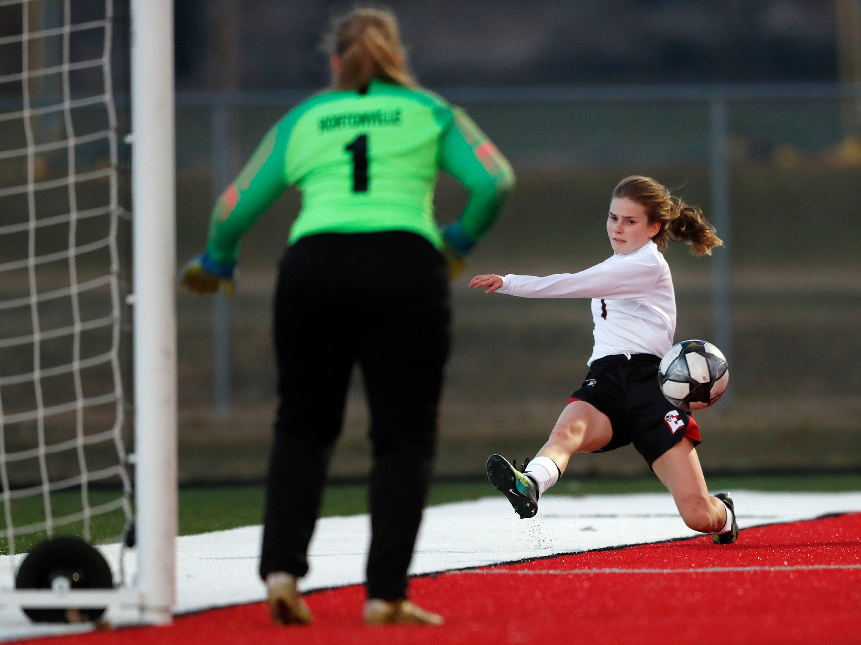 Green Bay East High School's Ellena Gallegas passes the ball into the box during their match against Hortonville High School Monday, April 8, 2019, in Hortonville, Wis. Danny Damiani/USA TODAY NETWORK-Wisconsin