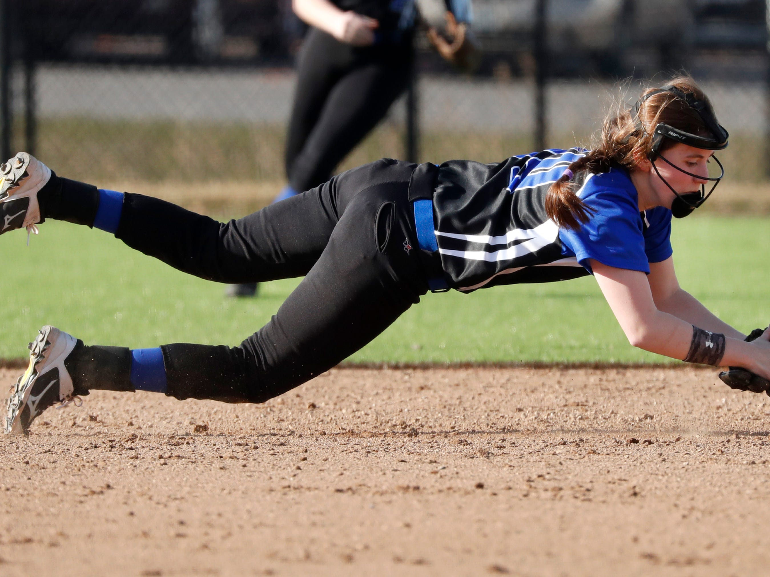 Oshkosh West High School's Olivia Torres catches a ground ball before throwing to first base for an out against Kaukauna High School Tuesday, April 9, 2019, in Kaukauna, Wis. Kaukauna High School defeated Oshkosh West High School 3-1.Danny Damiani/USA TODAY NETWORK-Wisconsin