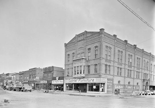 Gabriel Furniture is shown here in a Post-Crescent photo from 1967. The current-day metal panels were added later to cover the brick facade.