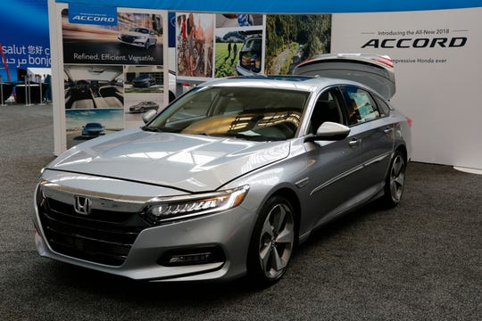 In this Feb. 15, 2018 file photo, a 2018 Honda Accord is displayed at the Pittsburgh Auto Show. Many shoppers can save thousands of dollars by getting a non-luxury-branded vehicle that still provides high levels of comfort and safety.