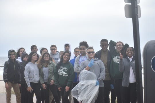 Students from Long Branch Middle School did a beach cleanup on Thursday, April 18, 2019, to celebrate Earth Day.
