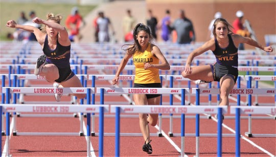 Wylie's Madison Latham, right, and teammate Ambria Brekke, left, compete in the girls 100-meter hurdles, along with Amarillo High's Symone Quiles. Latham and Brekke finished 1-2 in the event at the Districts 3/4-5A area track meet Thursday, April 18, 2019, at Lowrey Field in Lubbock.