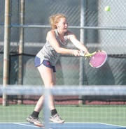 Jim Ned sophomore Katie Wyndham backhands a ball during a semifinal match at the Region I-3A tennis tournament Thursday, April 18, 2019, at Rose Park in Abilene.