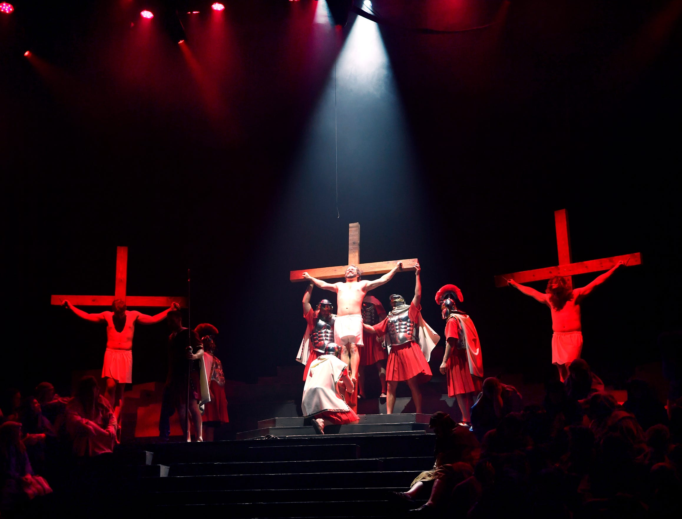 """Roman soldiers lift the cross with Jesus on it, played by John Whitten April 12, 2019 at the Abilene Convention Center. The Pioneer Drive Baptist Church Easter pageant, """"Jesus: His Story"""", concludes Saturday."""