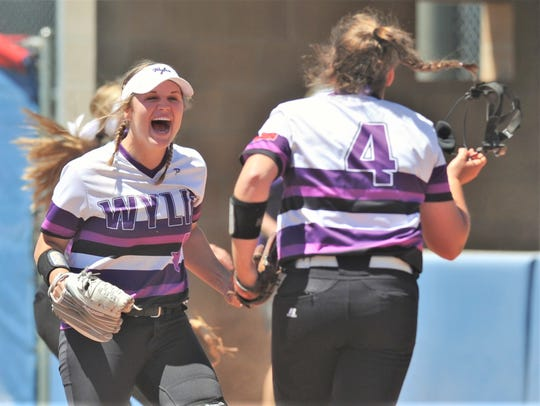Wylie first baseman Kaylee Philipp, left, celebrates with pitcher Bailey Buck (4) after the Lady Bulldogs beat Cooper 12-6 on Friday, April 19, 2019, to win the District 4-5A title in the district finale at Cougar Diamond. Buck won the game in relief of Philipp, who was Wylie's starting pitcher.