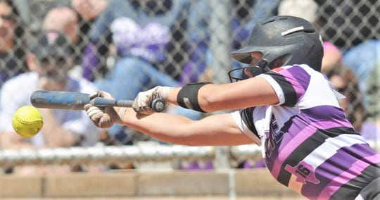 Wylie's Lilly New bunts in the seventh inning. She reached on the play when Cooper couldn't get force on the fielder's choice. New later came around to score in a four-run seventh. Wylie beat the Lady Cougars 12-6 to win the District 4-5A title in the district finale Friday, April 19, 2019, at Cougar Diamond.