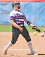 Wylie pitcher Bailey Buck throws a pitch in the sixth inning against Cooper. Wylie beat the Lady Cougars 12-6 to win the District 4-5A title in the district finale Friday, April 19, 2019, at Cougar Diamond.