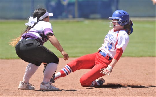 Wylie shortstop Halle Arbilera, left, tags out Cooper's Summer Simmons to cap a game-ending double play. Wylie beat the Lady Cougars 12-6 to win the District 4-5A title in the district finale Friday, April 19, 2019, at Cougar Diamond. Both teams began the day tied for first.