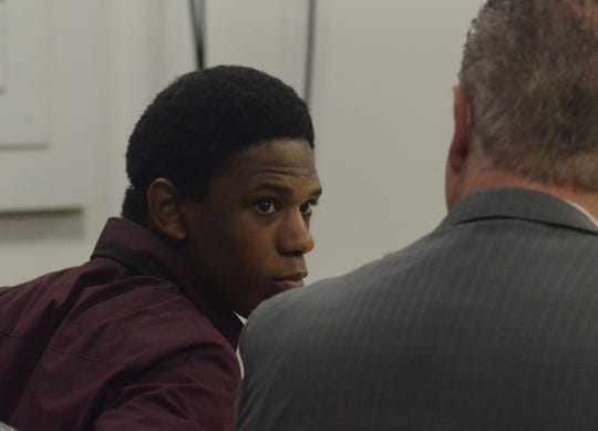 Davion Brown speaks with his attorney, Donald Sappanos  Friday in court.