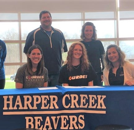Harper Creek's Rowe signs to play women's lacrosse at Lourdes University