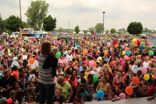 Television personality Maranda speaks to a crowd at one of her Maranda Park Parties.