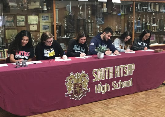 South Kitsap athletes sign letters of intent Thursday during a ceremony at the high school.