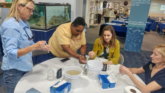 Members of LEAD Brevard's Class of 2019 do water-quality tests at the Lagoon House in Palm Bay.