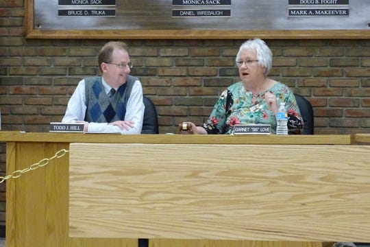 """Council President Garnet """"Sis"""" Love sits next to council clerk Todd Hill during a meeting of Bucyrus City Council on Tuesday, April 16."""