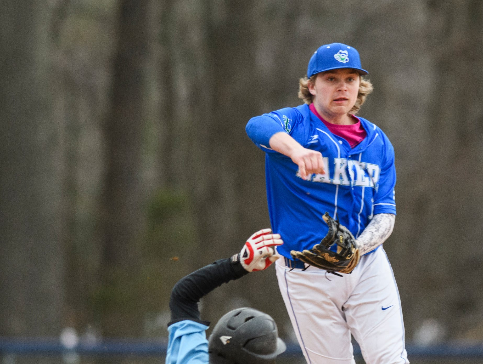 Colchester short stop Eben Provost (10) throws to first base for the double play during the boys baseball game between the South Burlington Wolves and the Colchester Lakers at Colchester high school on Thursday afternoon April 18, 2019 in Colchester, Vermont.