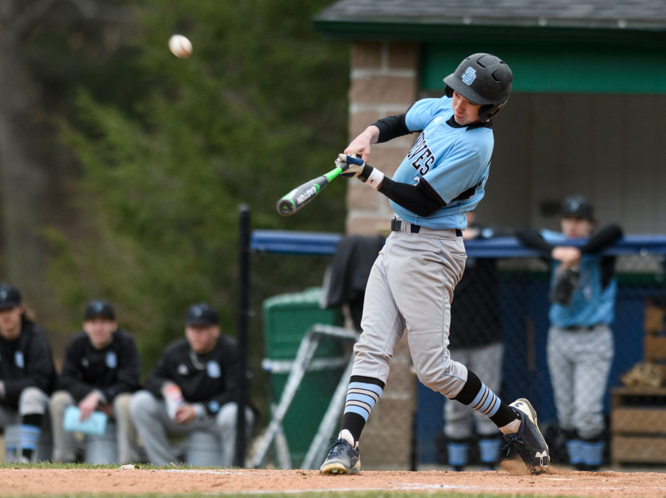 South Burlington's Nolan Antonicci (2) hits the ball during the boys baseball game between the South Burlington Wolves and the Colchester Lakers at Colchester high school on Thursday afternoon April 18, 2019 in Colchester, Vermont.