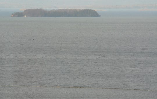 The waters of Lake Champlain nearly cover the breakwater along Burlington Bay seen in the foreground on Friday, April 19, 2019.