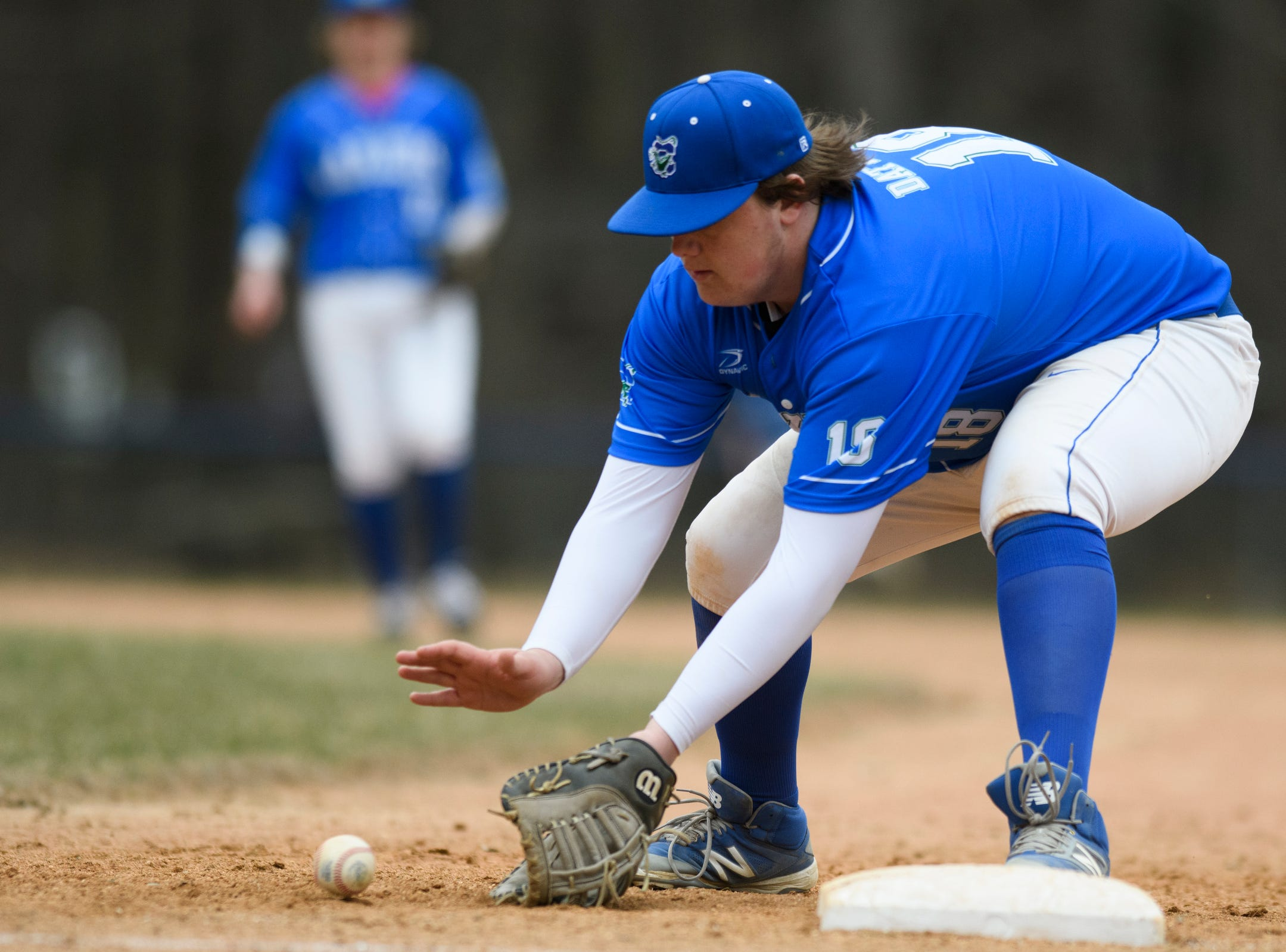 Colchester first baseman Justin Dattilio (18) plays the ground ball during the boys baseball game between the South Burlington Wolves and the Colchester Lakers at Colchester high school on Thursday afternoon April 18, 2019 in Colchester, Vermont.