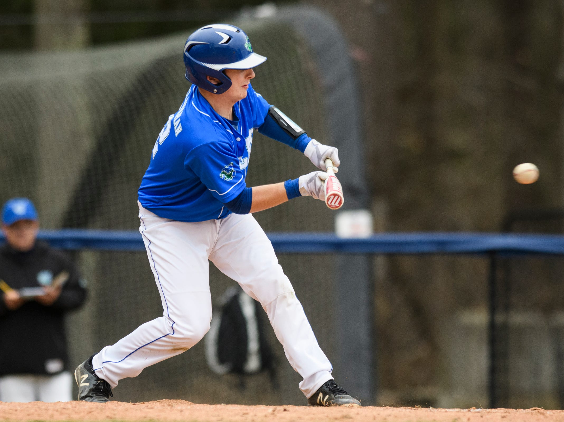 Colchester's Lucas McClanahan (22) tries to bunt the ball during the boys baseball game between the South Burlington Wolves and the Colchester Lakers at Colchester high school on Thursday afternoon April 18, 2019 in Colchester, Vermont.
