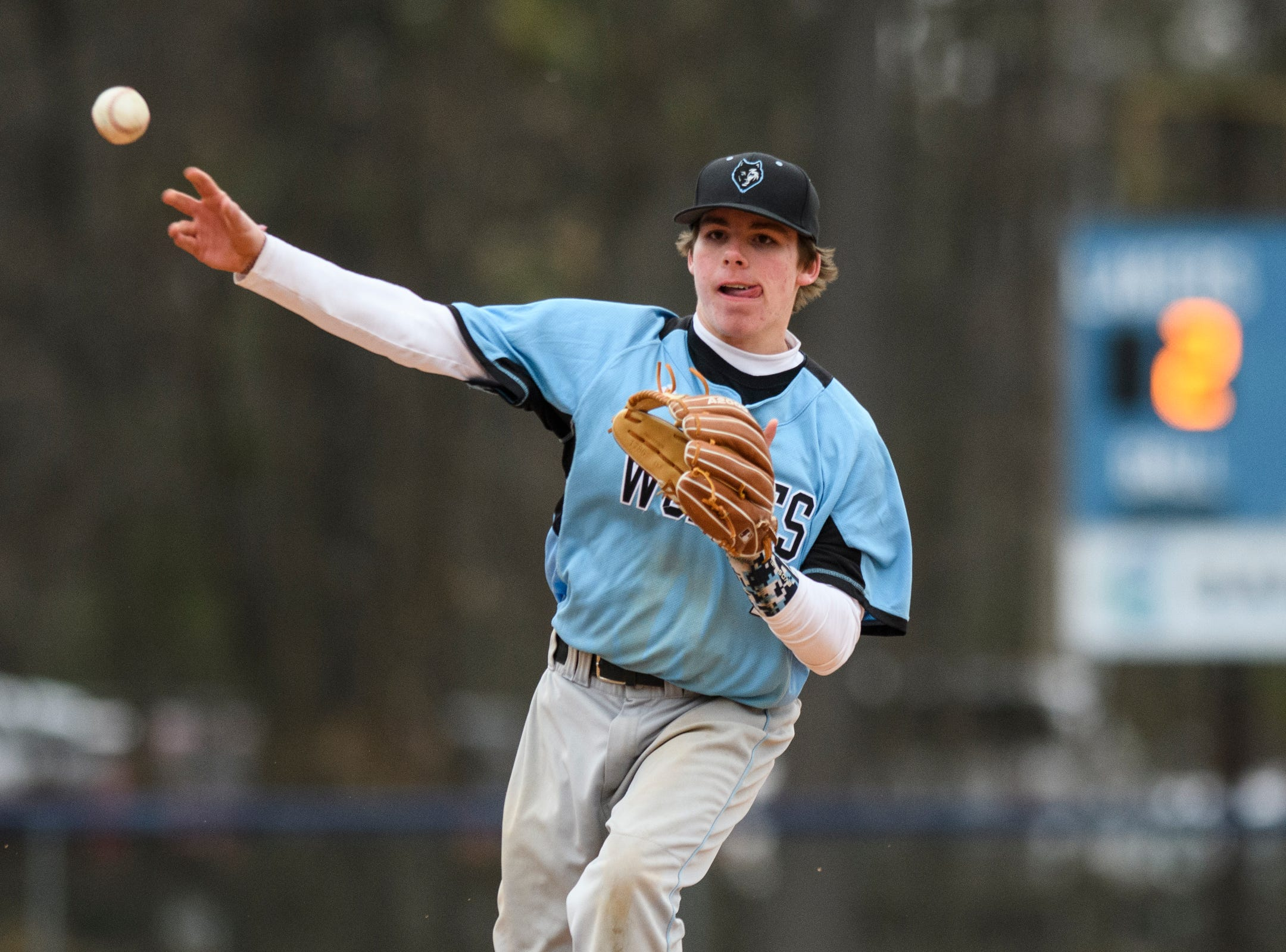 South Burlington's Carson Cherry (7) throws the ball to first for an out during the boys baseball game between the South Burlington Wolves and the Colchester Lakers at Colchester high school on Thursday afternoon April 18, 2019 in Colchester, Vermont.