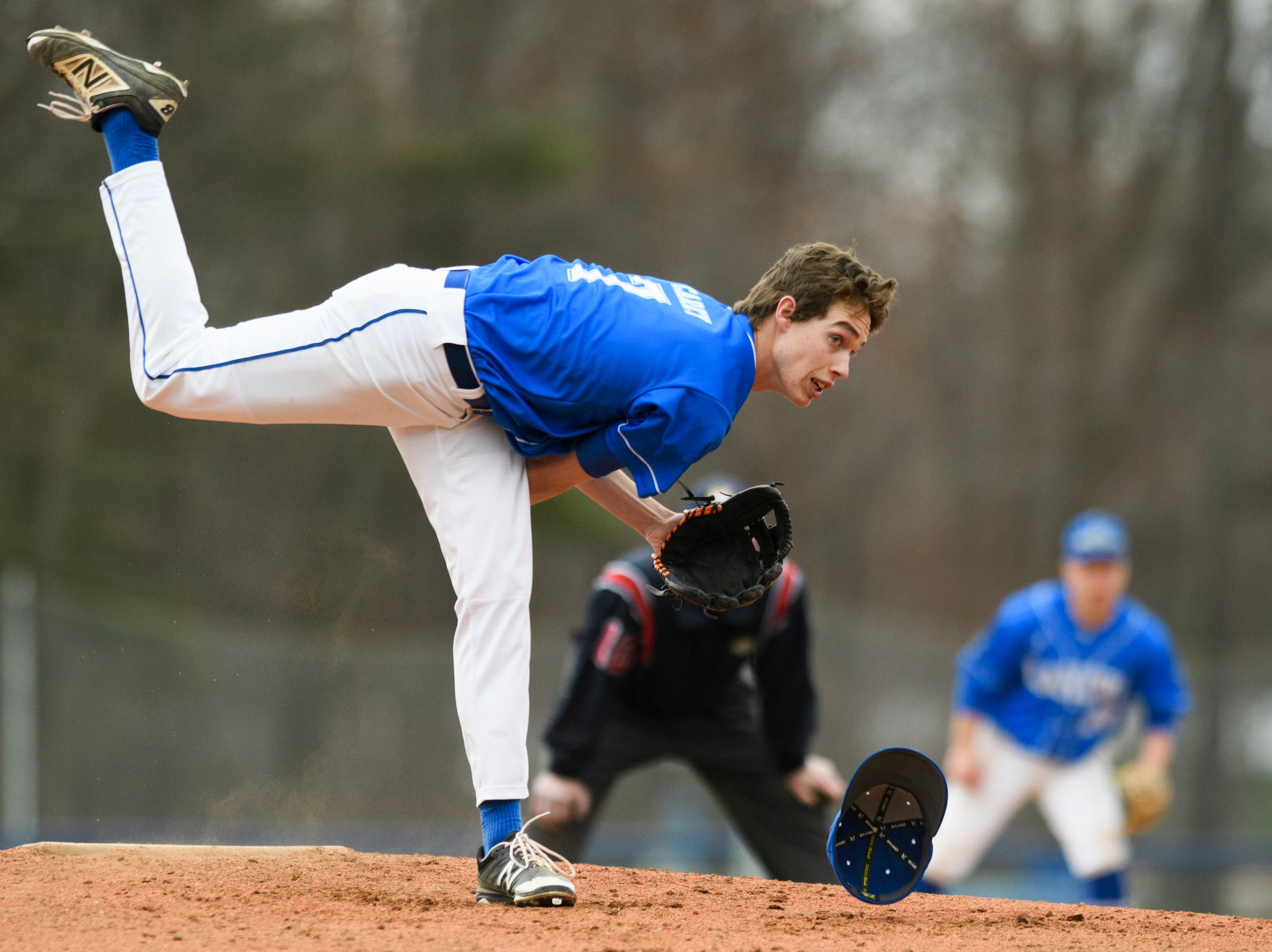 Colchester pitcher Chase Carey (7) loses his hat as he delivers a pitch during the boys baseball game between the South Burlington Wolves and the Colchester Lakers at Colchester high school on Thursday afternoon April 18, 2019 in Colchester, Vermont.