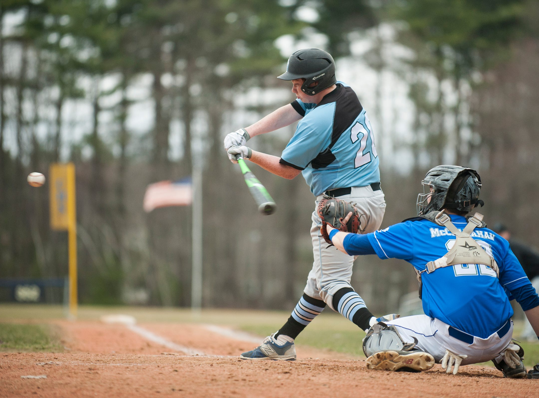 South Burlington's Ethan Moore (20) swings at a pitch during the boys baseball game between the South Burlington Wolves and the Colchester Lakers at Colchester high school on Thursday afternoon April 18, 2019 in Colchester, Vermont.