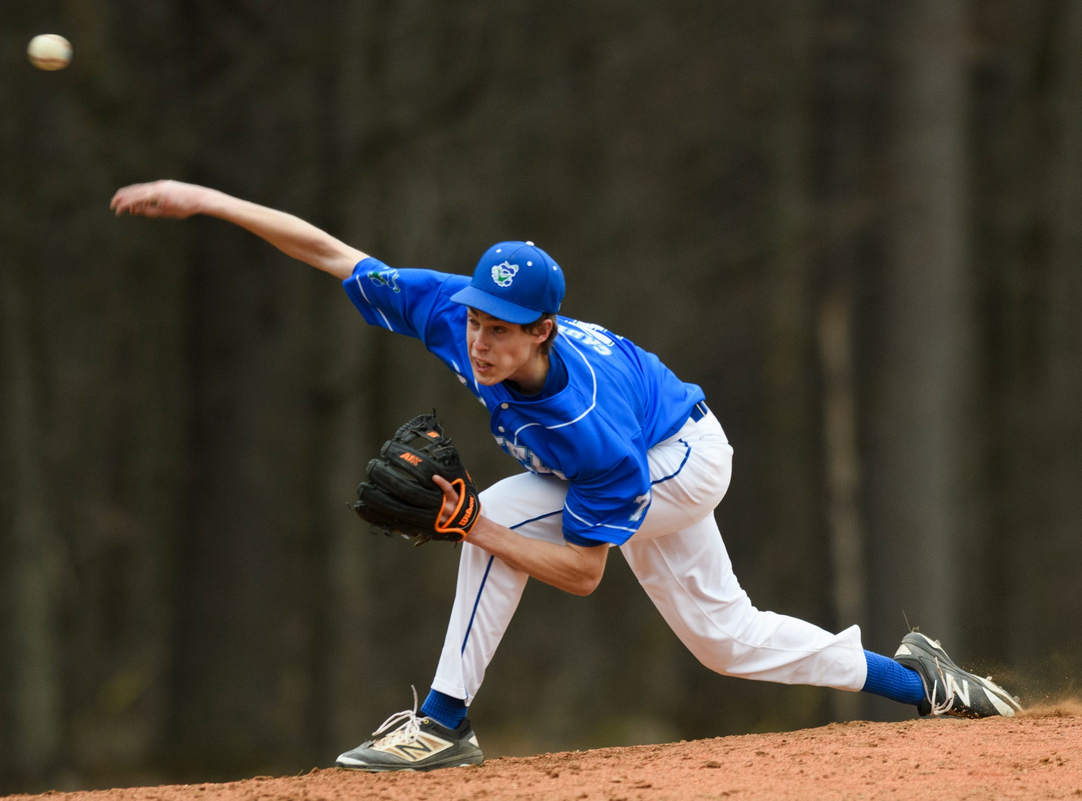 Colchester pitcher Chase Carey (7) delivers a pitch during the boys baseball game between the South Burlington Wolves and the Colchester Lakers at Colchester high school on Thursday afternoon April 18, 2019 in Colchester, Vermont.