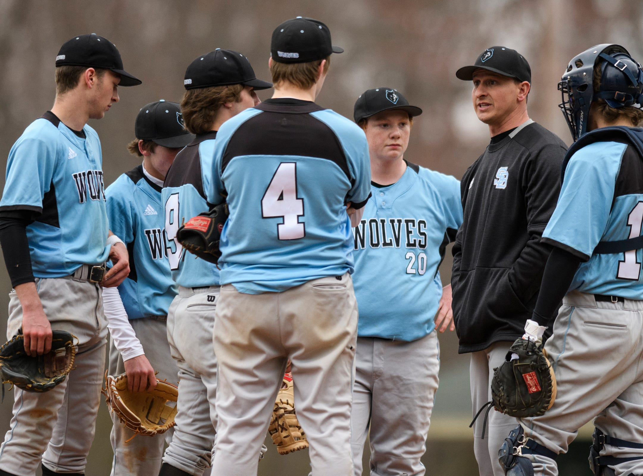 South Burlington head coach Like Goyette talks to the team during the boys baseball game between the South Burlington Wolves and the Colchester Lakers at Colchester high school on Thursday afternoon April 18, 2019 in Colchester, Vermont.