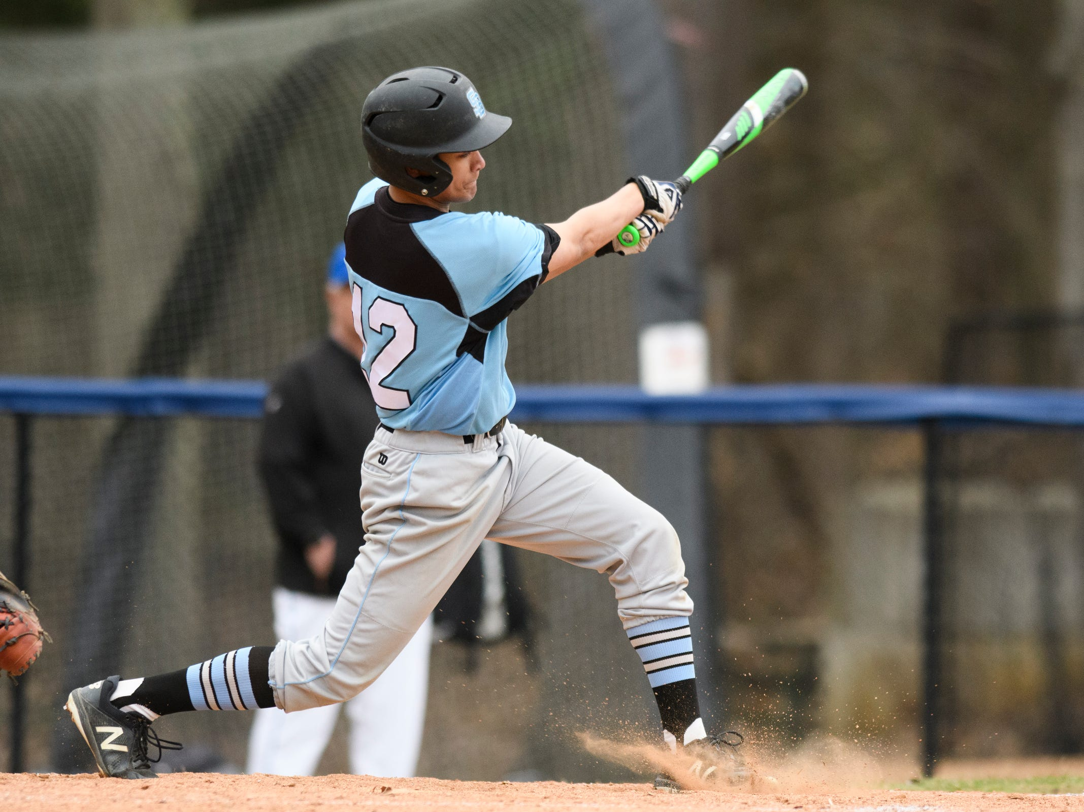 South Burlington's Gabe Frigo (12) hits the ball during the boys baseball game between the South Burlington Wolves and the Colchester Lakers at Colchester high school on Thursday afternoon April 18, 2019 in Colchester, Vermont.
